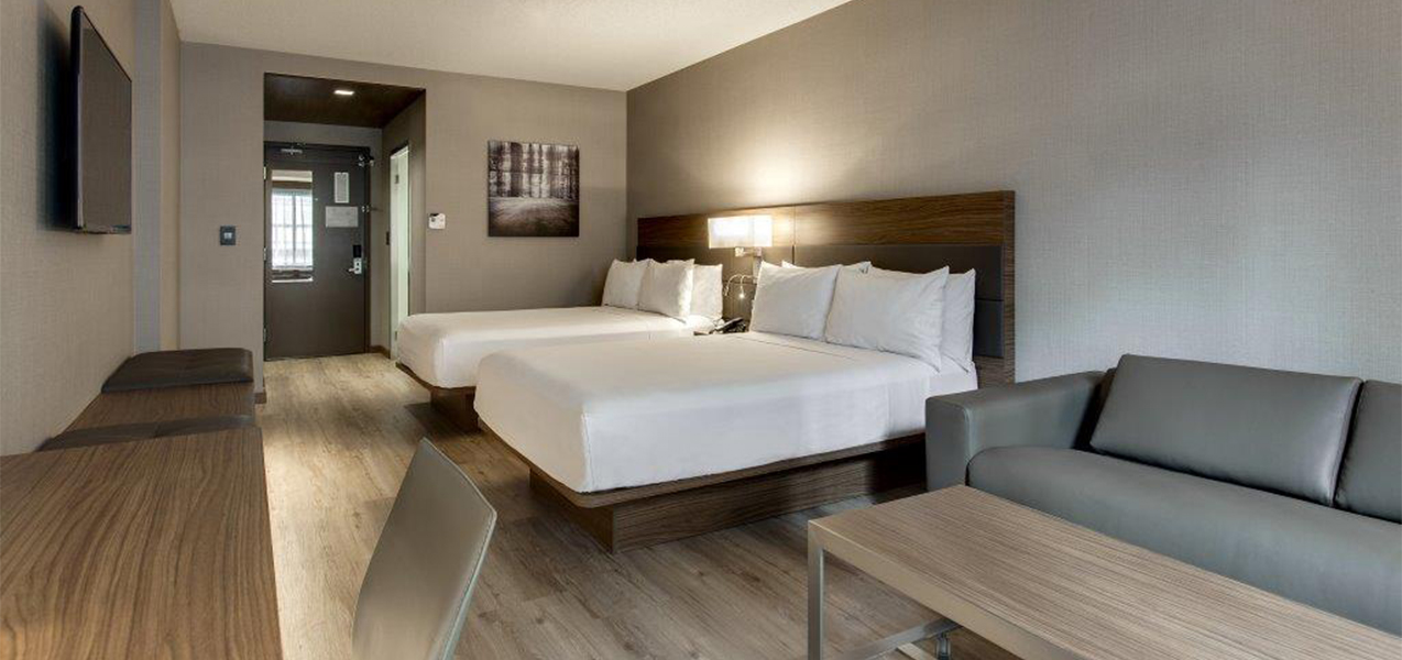 Remodeled hotel room with two beds in the AC Hotel in Chicago, IL, from Tri-North Builders.