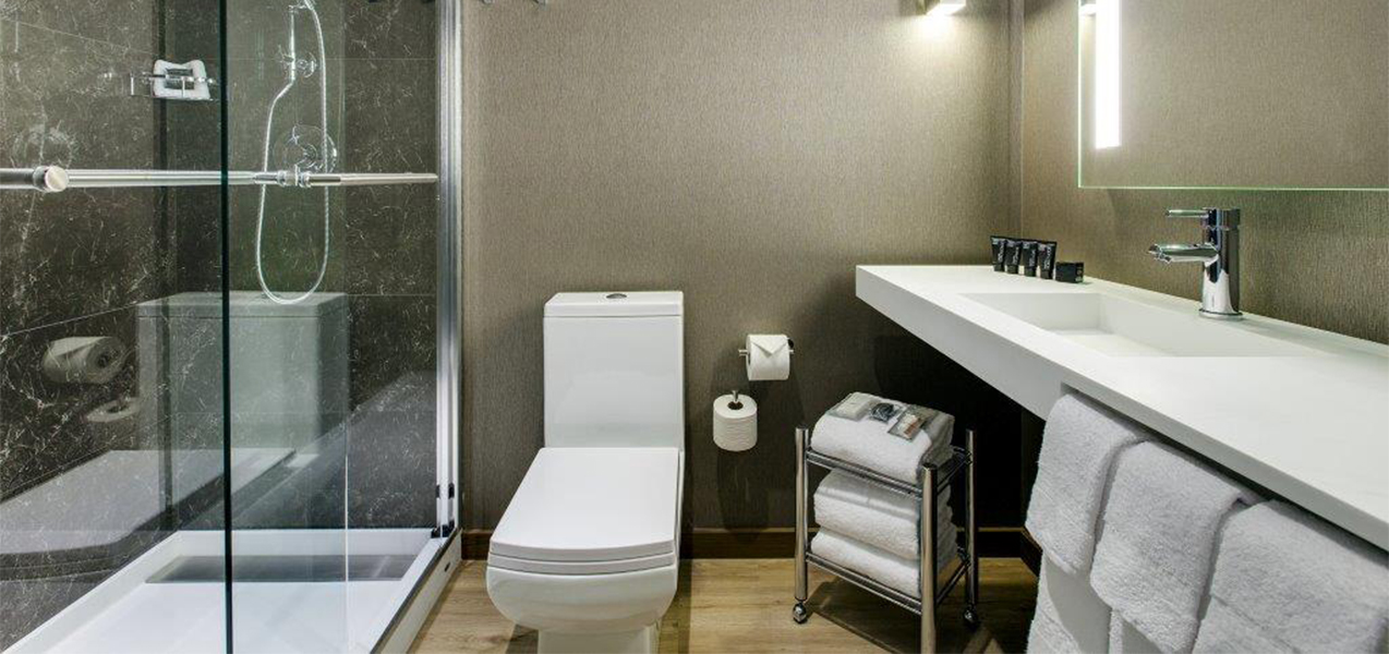 Tri-North Builders remodeled bathroom inside room at the AC Hotel Chicago.