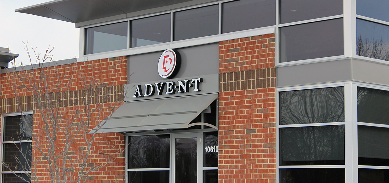 Front door and sign for Advent healthcare in Mequon, WI, which was remodeled by Tri-North Builders.