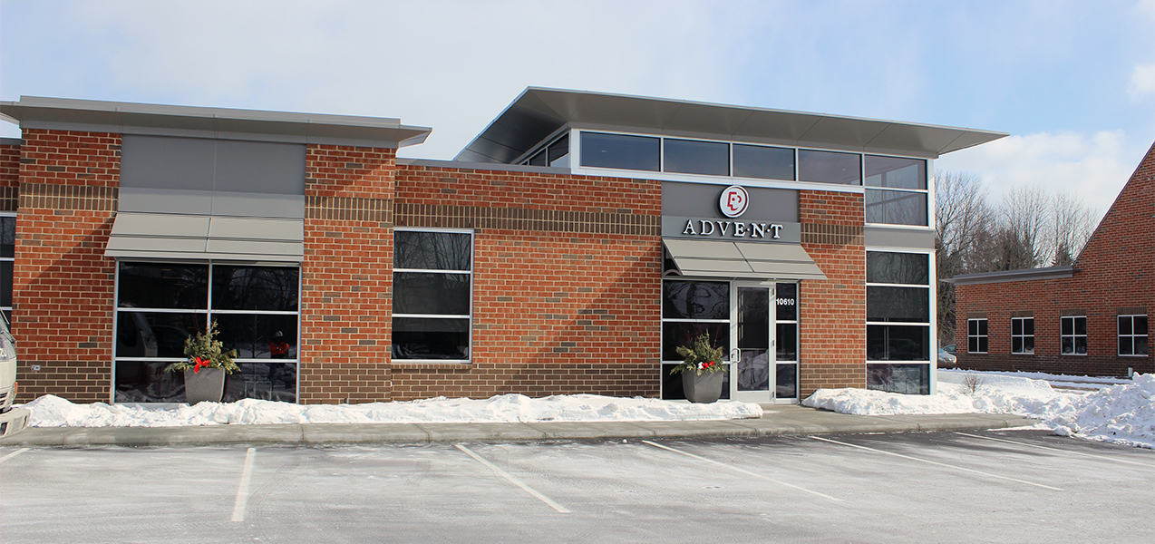 Front of Advent building with parking spaces in the snow in Mequon, WI, as Tri-North Builders project.