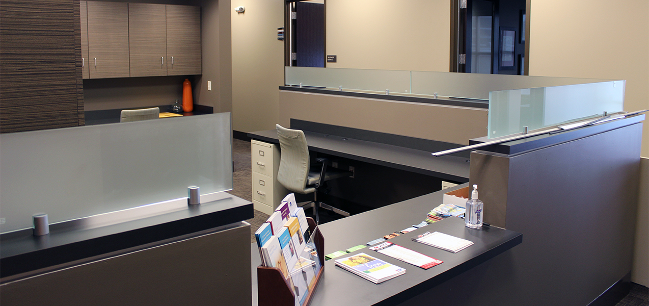 Remodeled reception desk by Tri-North Builders for Advent health care services in Mequon, Wisconsin.
