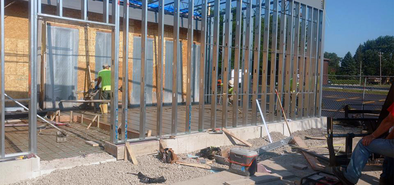 A Tri-North team member works within the framed out walls of a new ALDI store.
