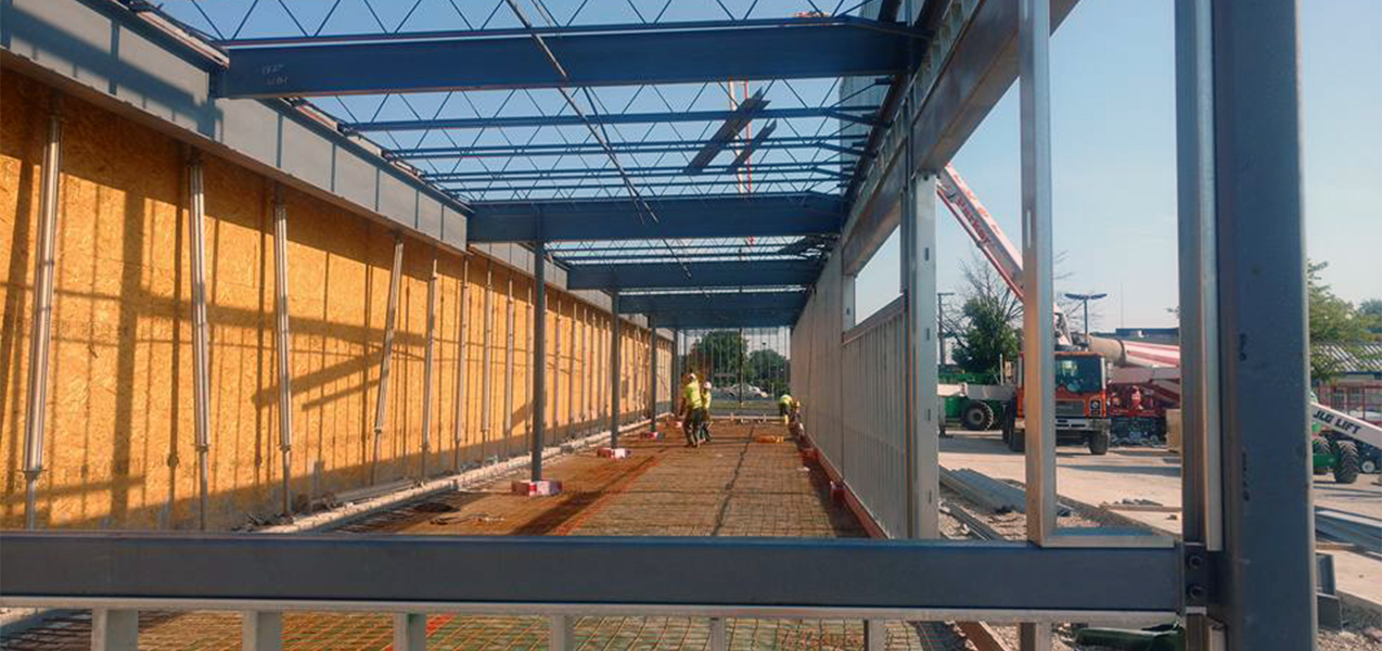 Members of the Tri-North construction team make progress on a new ALDI grocery store.