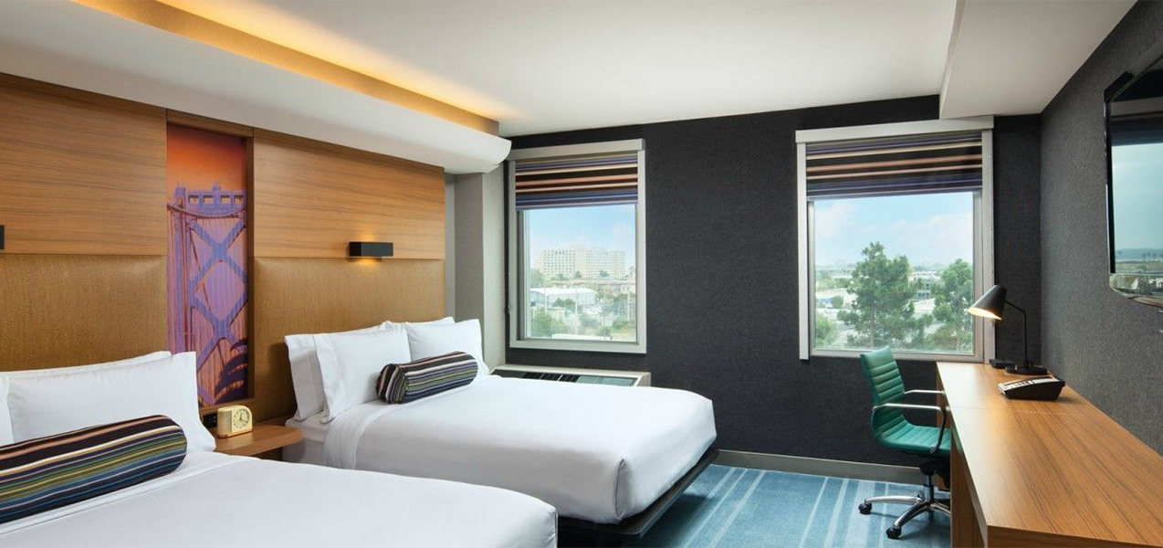Room with two beds inside the Aloft San Fran, remodeled by Tri-North Builders.