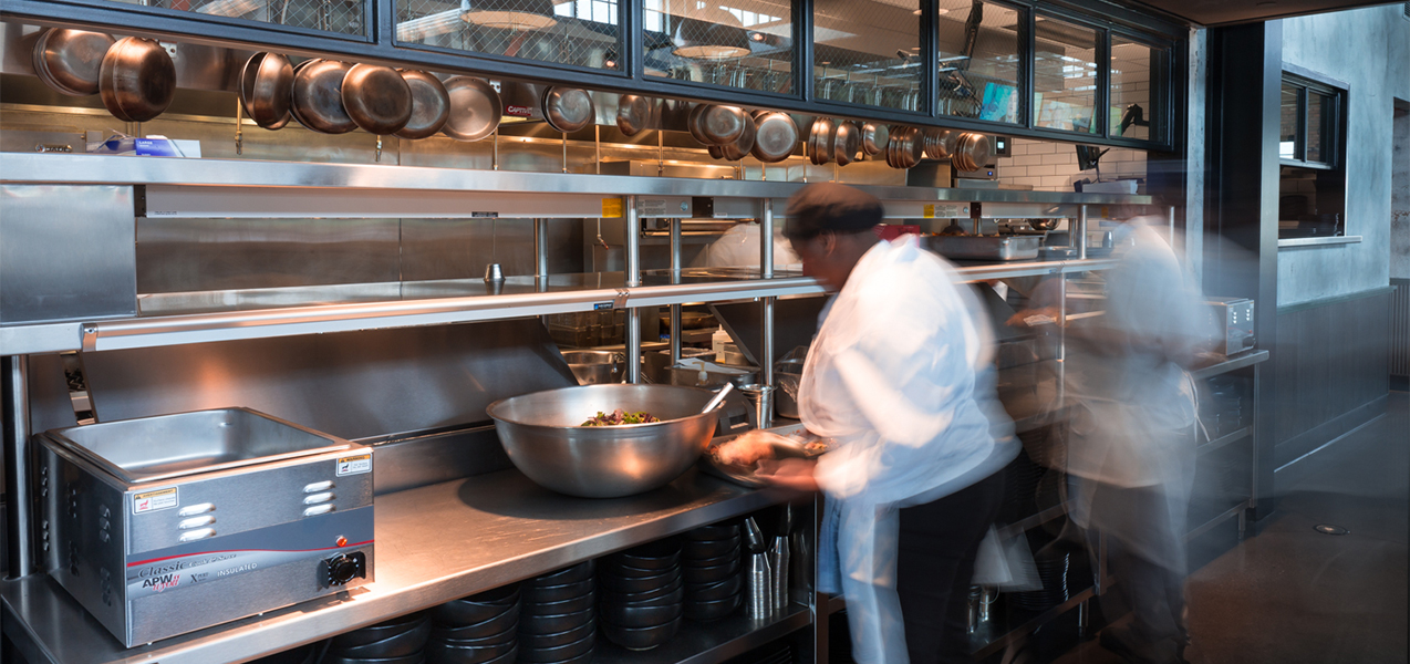 Kitchen with chefs inside the ABV Social restaurant in Wisconsin which is part of the Bartolotta Collection of restaurants