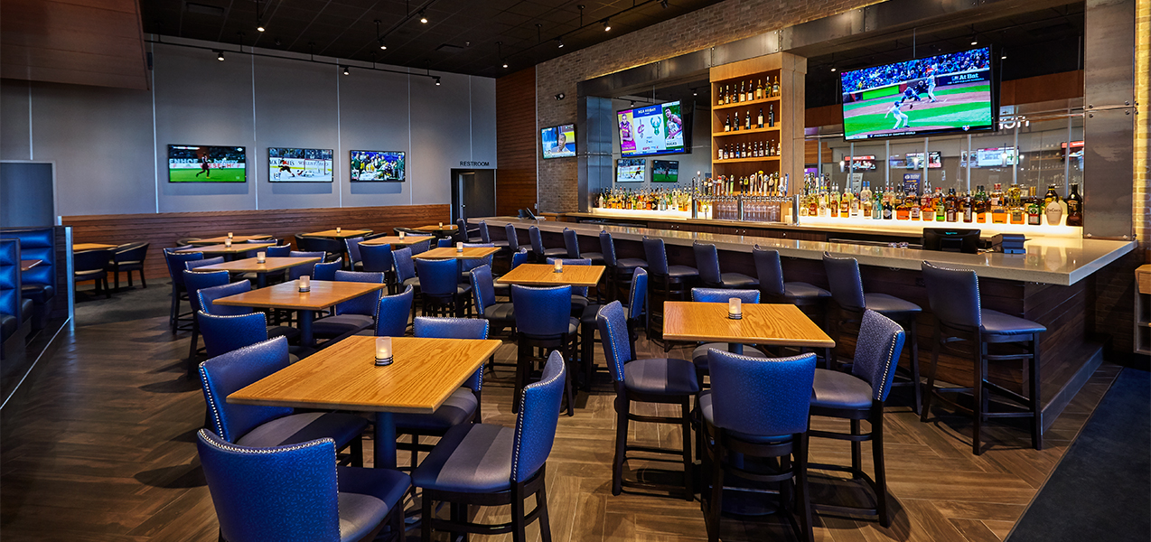 Dining area with tables and chair plus the bar in the Bistroplex Southridge movie theater complex in Greendale, WI.