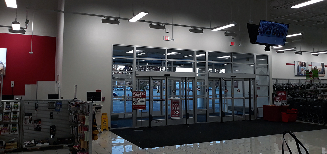 Sliding glass doors welcome shoppers to a Burlington store built by Tri-North.