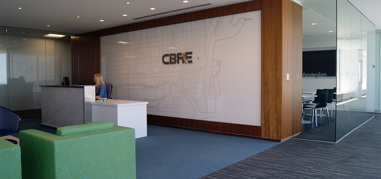 Receptionist area and waiting room inside the CBRE building in Milwaukee, WI, a Tri-North Builders project.