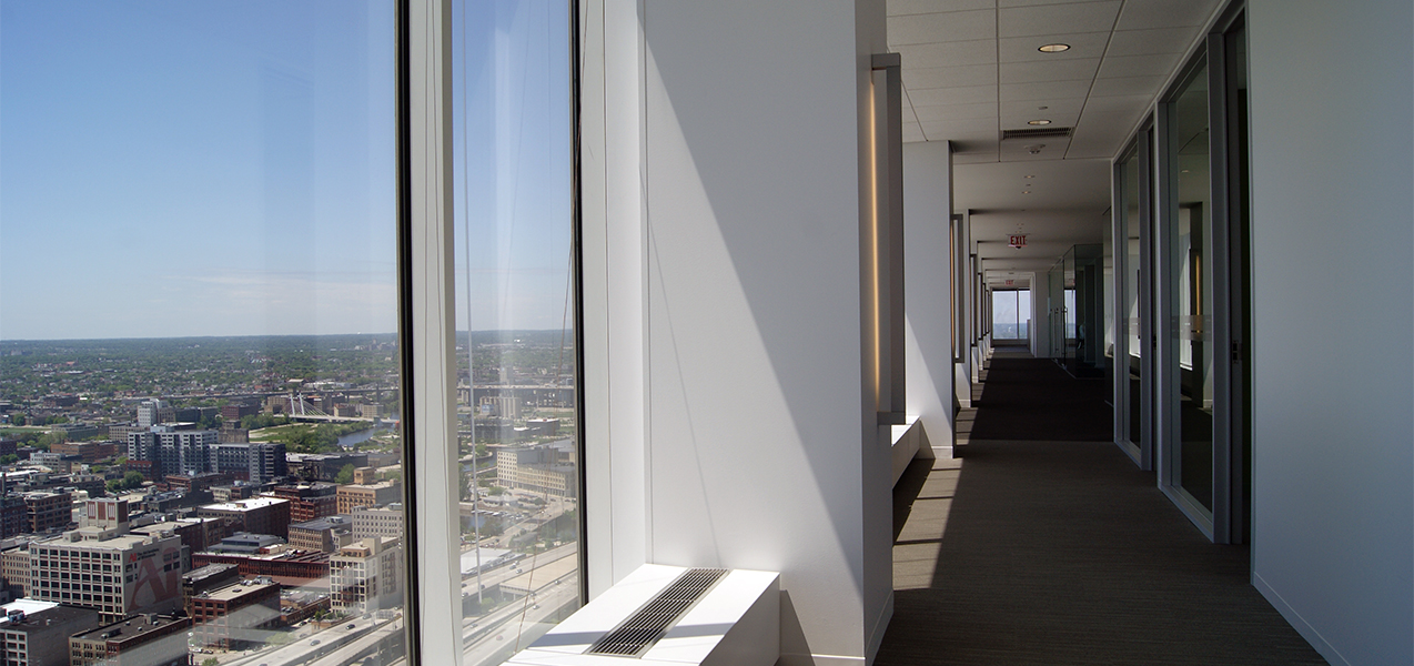 Hallway with windows overlooking Milwaukee, WI, at the Tri-North Builders project for the CBRE building.