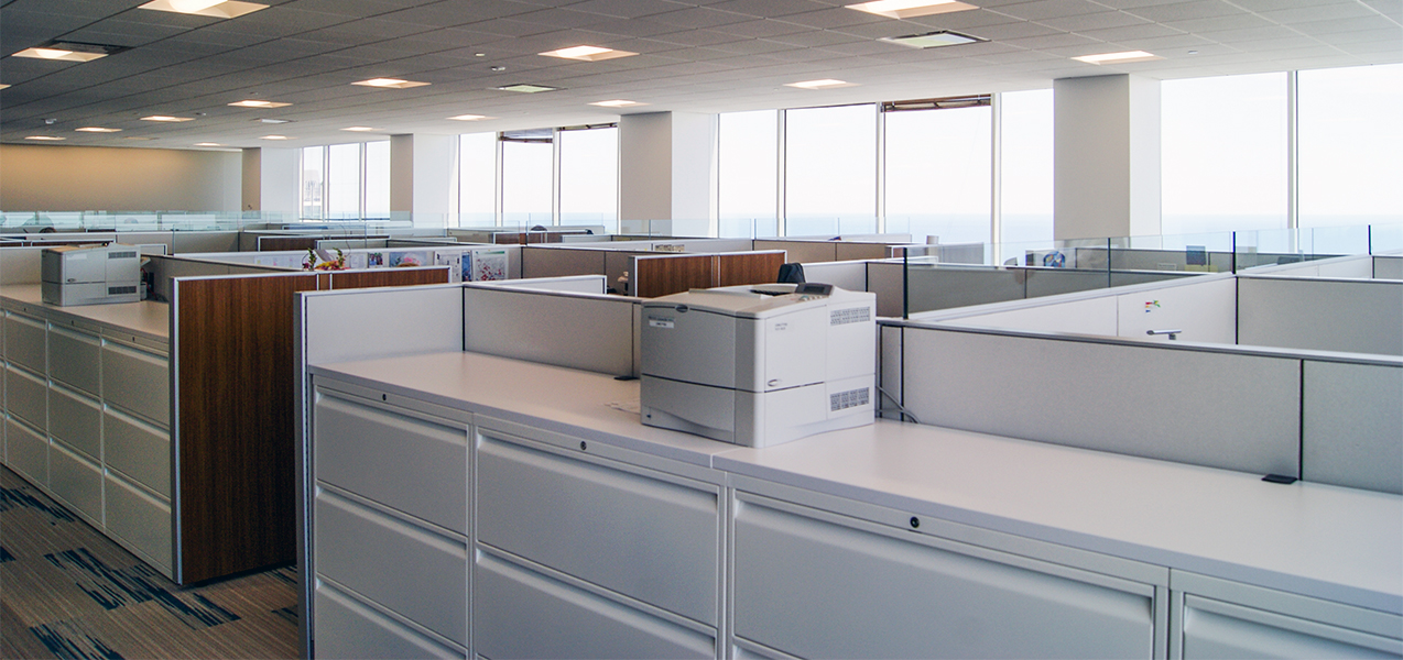 Office workspace and cubicles inside the CBRE building in downtown Milwaukee, WI, remodeled by Tri-North Builders.