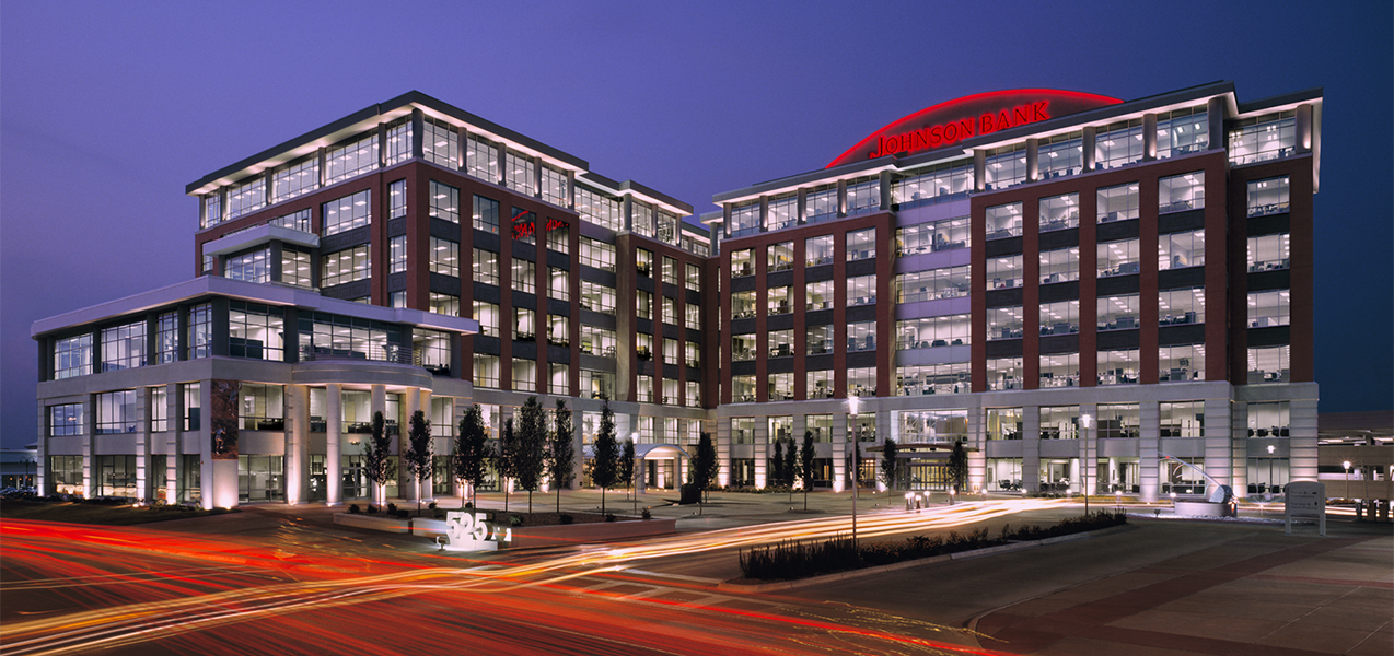 Nighttime shot of City Center West building with courtyard which was built by Tri-North Builders in Wisconsin.