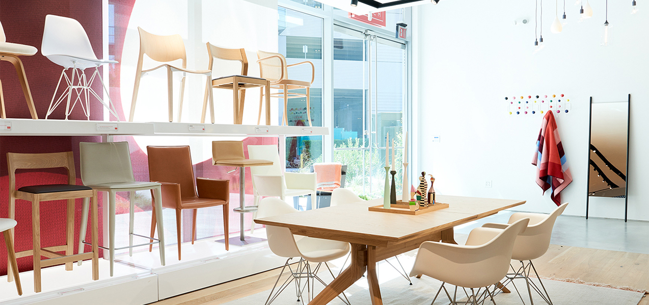 Chairs are on display at a Design Within Reach store built by Tri-North.