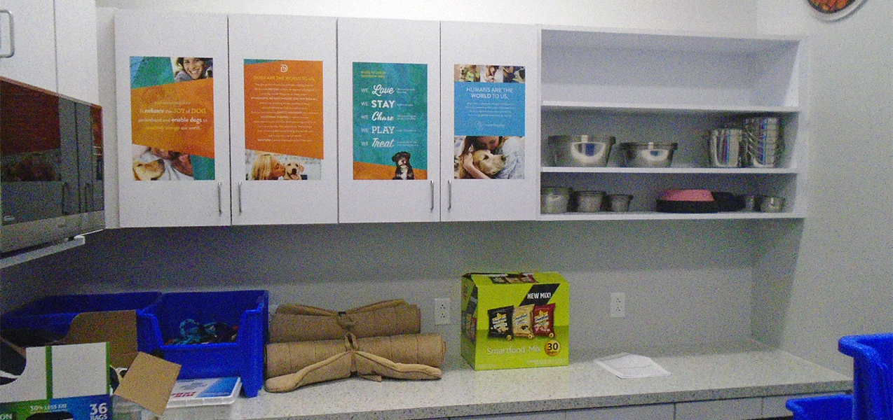 Cabinets and sheves house pet supplies at a Dogtopia built by Tri-North.