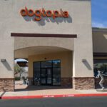 The Dogtopia sign was installed above the arched stone entryway of one location.