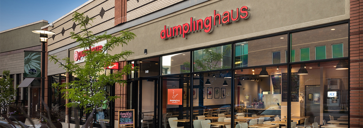 Front entrance and windows of Dumpling Haus restaurant including patio showcasing Tri-North Builder's work.