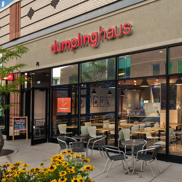 Exterior, front window, entrance and patio for the Dumpling Haus in Wisconsin.