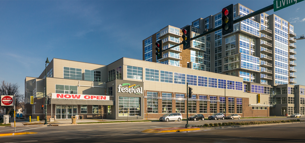 The Festival Foods grocery store is part of a large complex that also includes residences.