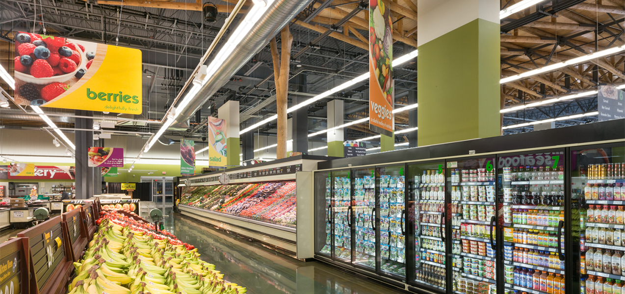 The Festival Foods produce sections features rows of stocked coolers.