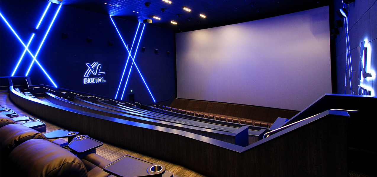 Remodeled screening room and theater with stadium seating inside Fridley Palms movie complex in Waukee, IA.