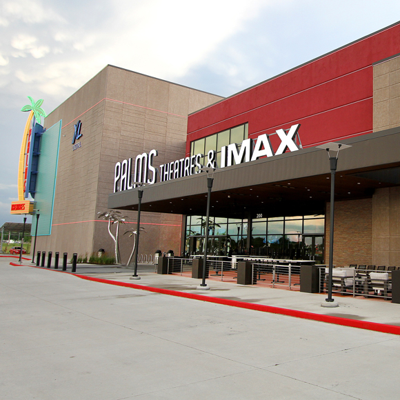 Exterior and front entrance of the Fridley Palms theater in Waukee, IA, a Tri-North Builders project.