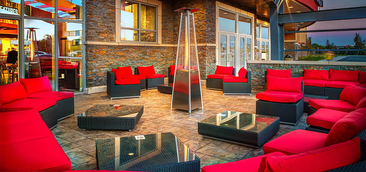 Outdoor seating area with red chairs at the GQT Riverview movie theater complex.