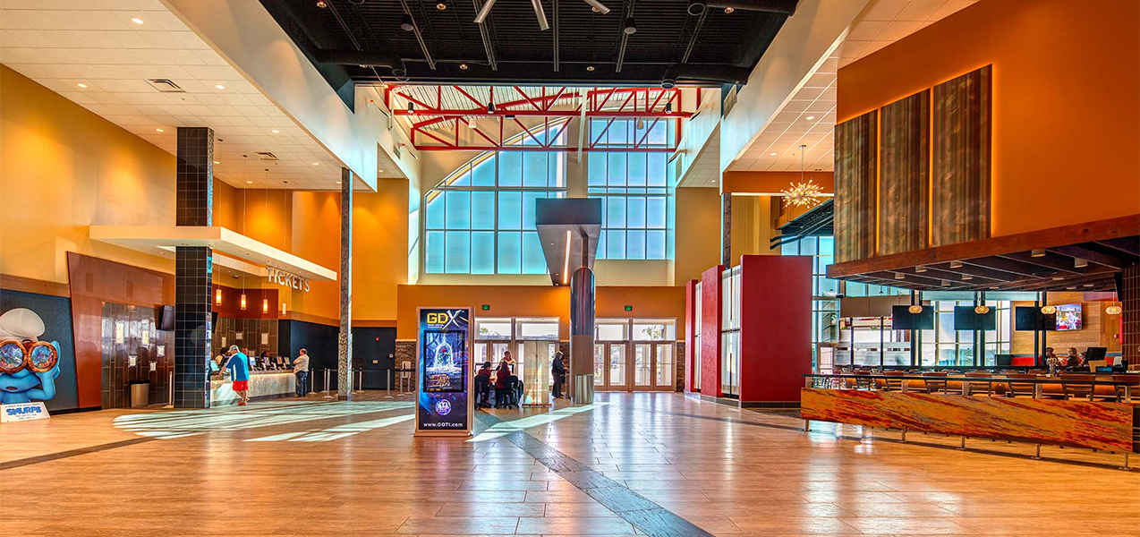 Lobby showing ticketing area and dining tables inside Tri-North Builders' GQT Riverview project in Florida.