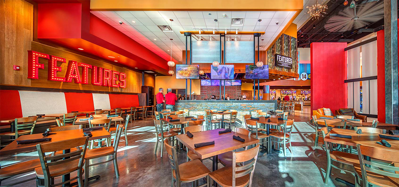 Dining tables and bar at GQT Riverview movie complex in Gibsonton, FL.