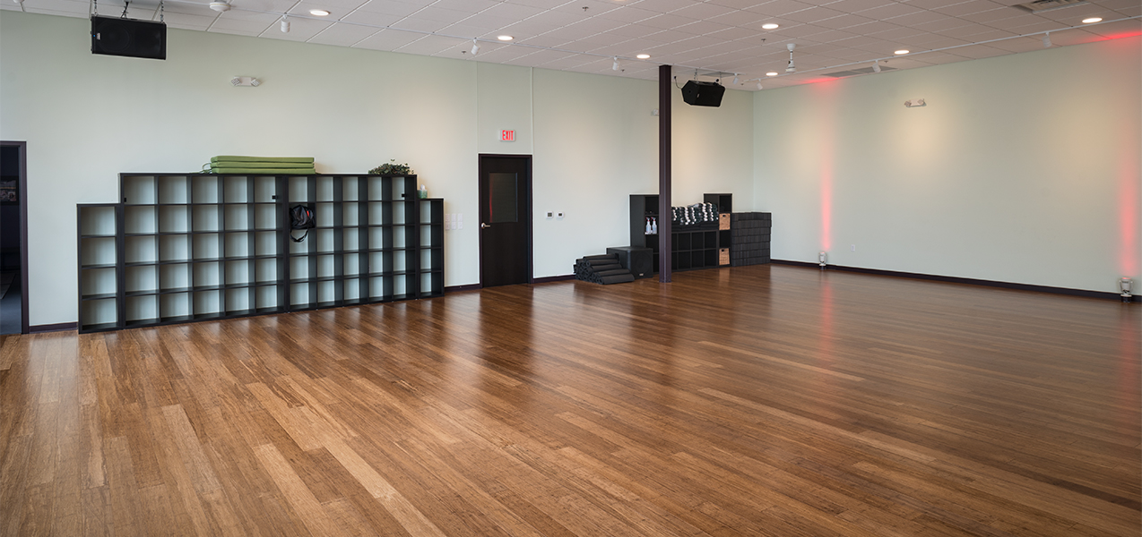 Open space with hardwood floors for events at the Galaxie Condominiums in Madison, WI, a Tri-North Builder project.