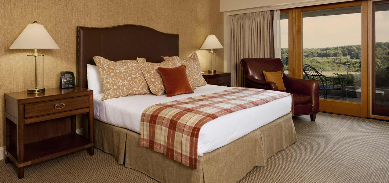 King sized bed inside a Tri-North Builders remodeled hotel room at the Grand Geneva Resort & Spa.