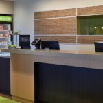 Front desk in the lobby of the Tri-North Builders project at Home2Suites by Hilton Madison Central Alliant Energy Center.
