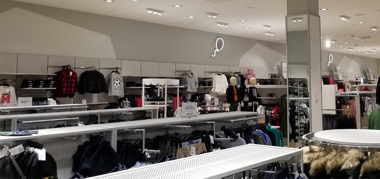 Winter clothing on racks at an H&M retail location, a Tri-North Builders project.