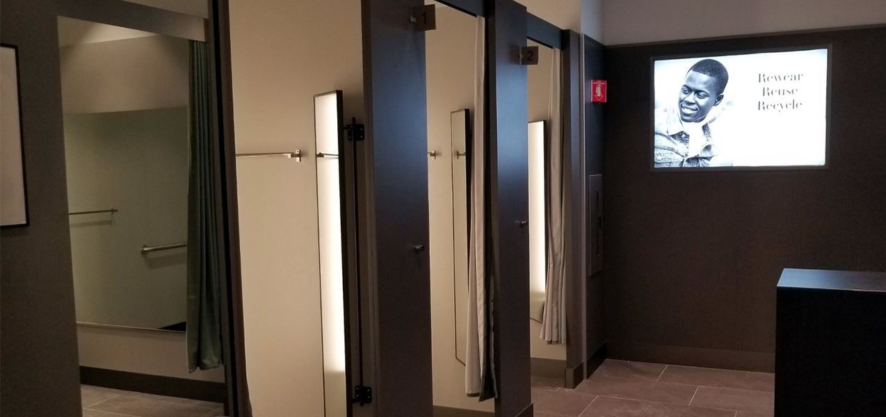 A row of dressing rooms in an H&M retail store constructed by Tri-North Builders.