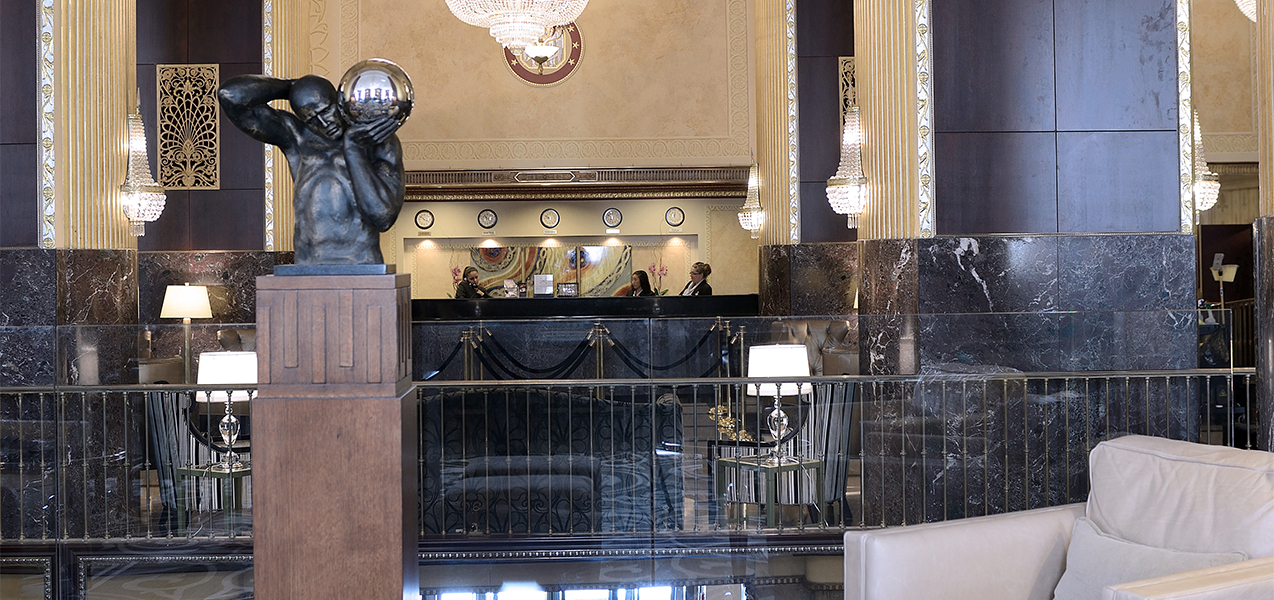 Statues, marble columns and front desk of the Hilton City Center in downtown Milwaukee, Wisconsin.