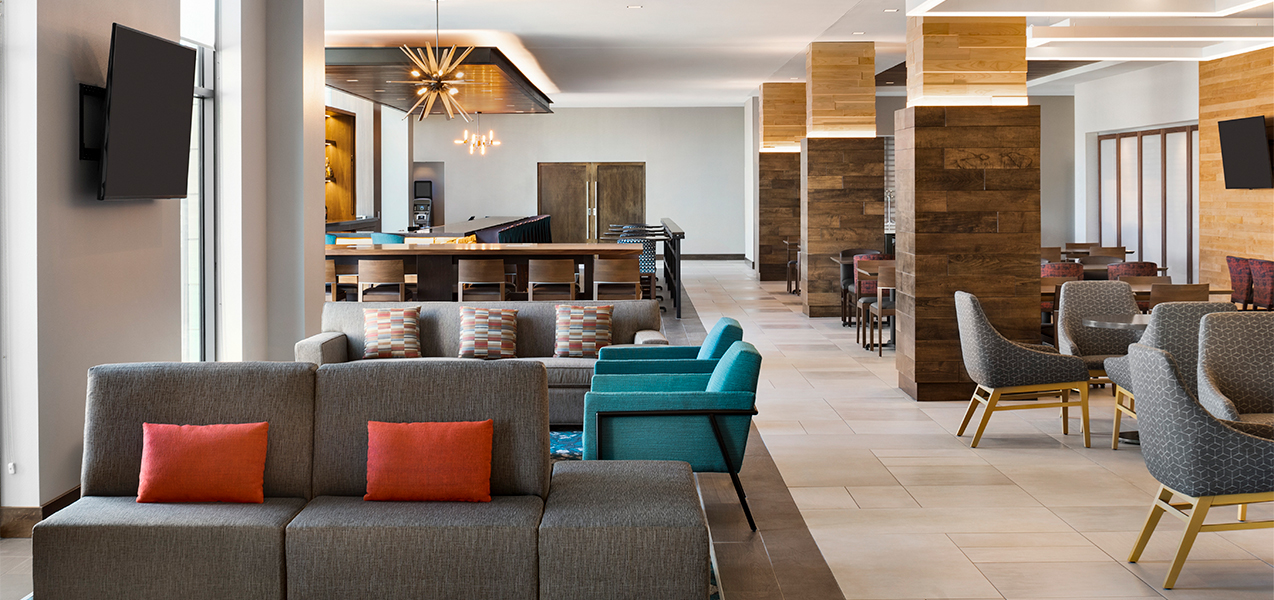 Lobby, chairs and sitting area of the Tri-North Builders remodeled Hilton Garden Inn and Conference Center in Brookfield, WI.