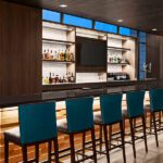 Tri-North Builders remodeled bar with bar stools inside the Hilton Garden Inn Milwaukee Brookfield Conference Center.