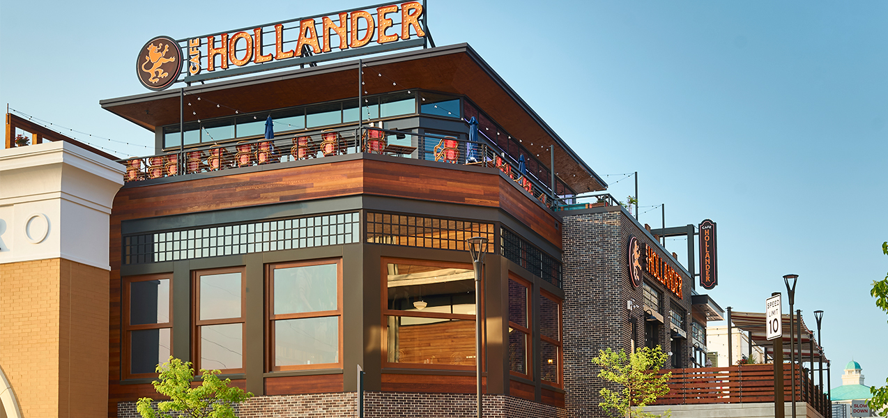 Tri-North builders Cafe Hollander project front windows and outdoor seating area.