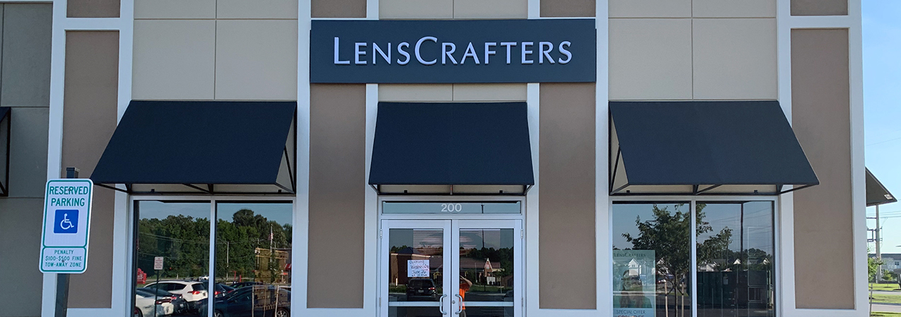 The LensCrafters sign is installed above the front entrance to this location, built by Tri-North.
