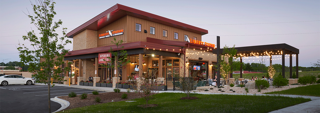 Parking lot, building, patio and front entrance of the Liberty Station restaurant in Wisconsin.
