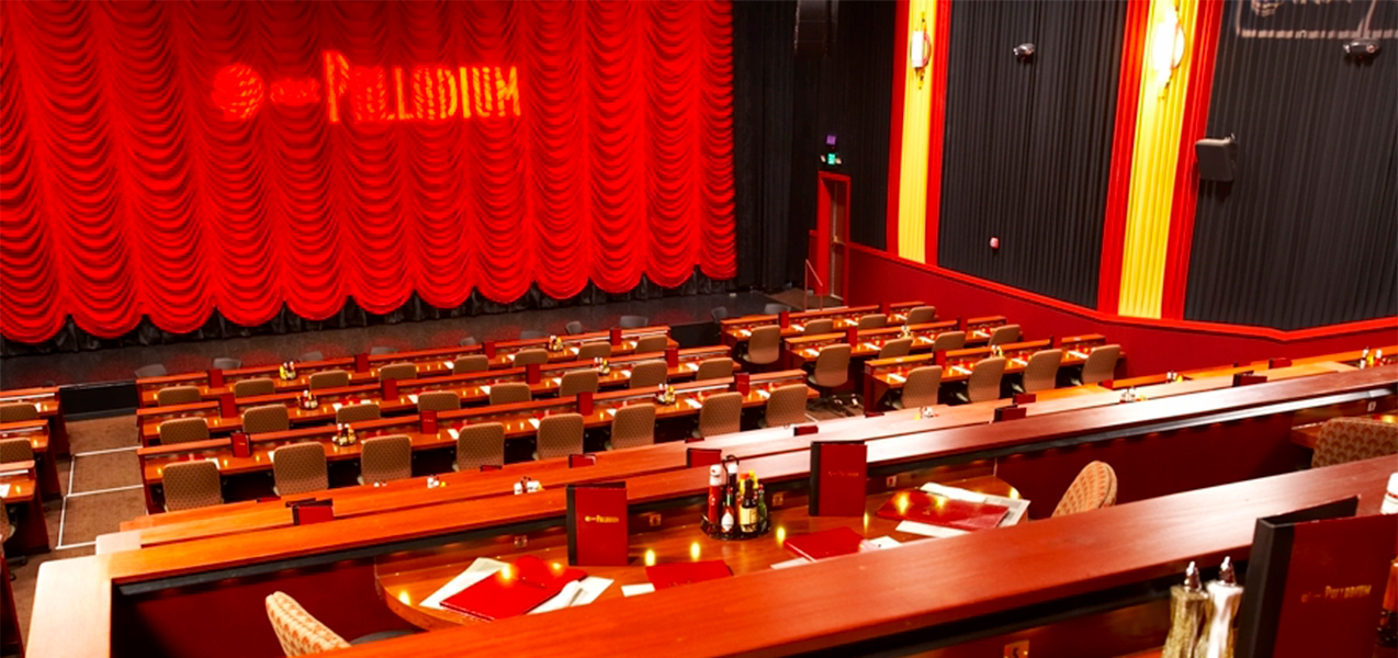 Indoor seating with chairs and dining tables at the Tri-North Builders project Majestic Cinema movie theater.