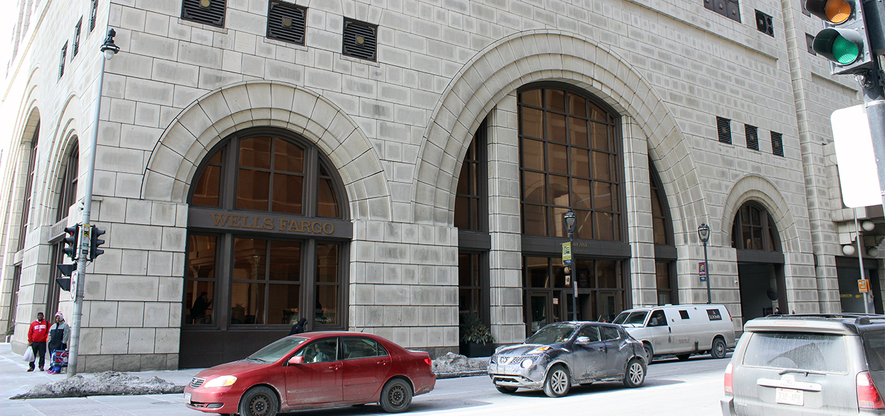 Full front of the Marcus Corporation HQ building with cars in front which is a Tri-North Builders project.