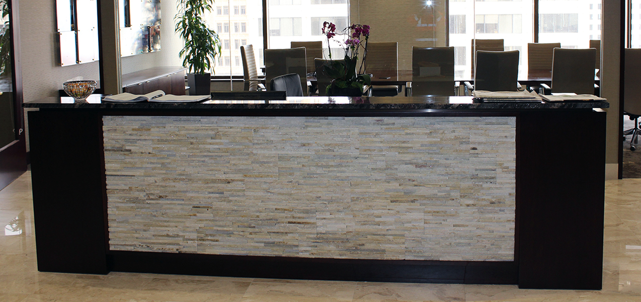 Receptionist desk in the remodeled Marcus Corp Headquarters by Tri-North Builders in Milwaukee, WI.