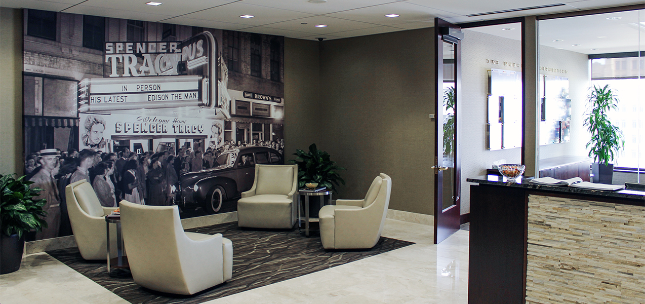 Receptionist desk and waiting area in lobby of new Marcus Corp HQ offices built by Tri-North Builders in Milwaukee, WI.