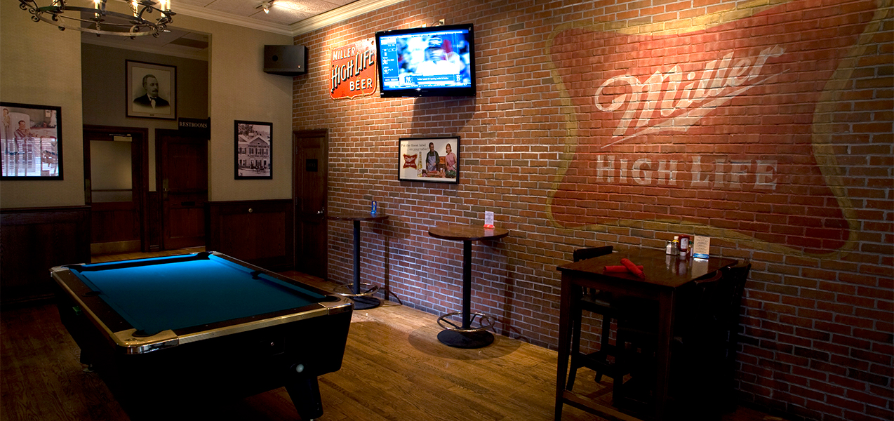 Pool table and game room built by Tri-North Builders inside the Miller Time Pub.