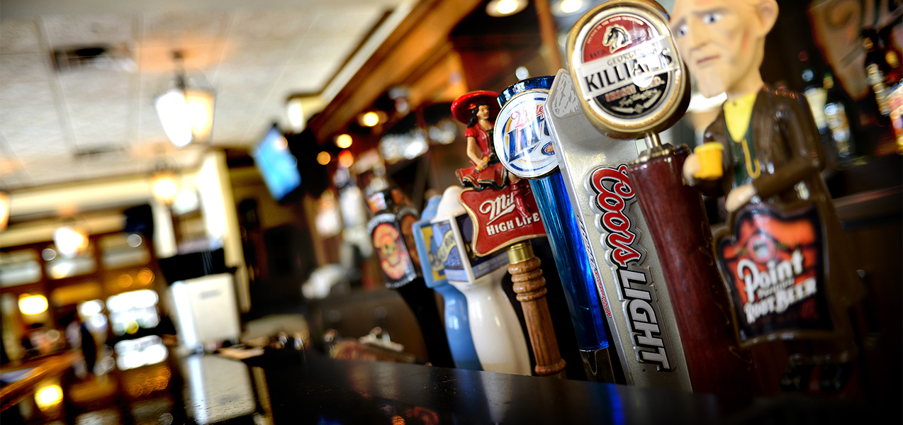 Close up of beer taps inside the Miller Time Pub bar in Wisconsin. A Tri-North Builders project.