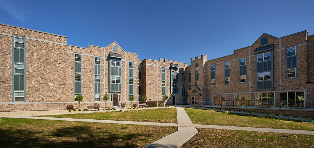 Courtyard and building showing the Newman Heights housing and apartments built by Tri-North Builders in Madison, WI.