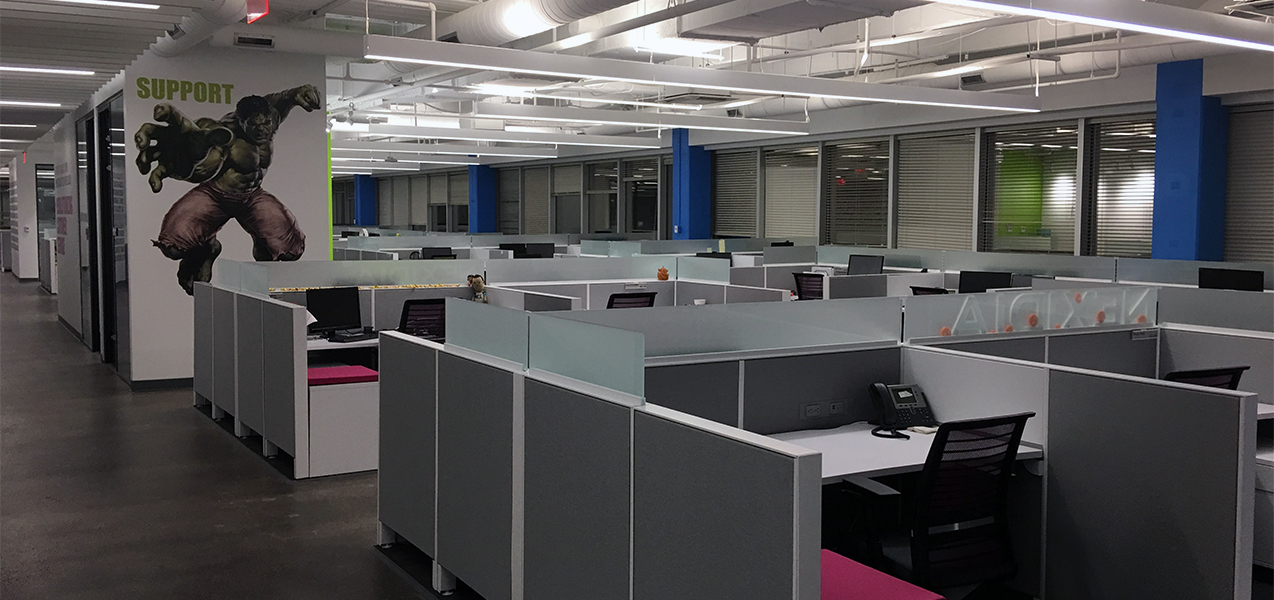 Cubicles fill a large open area at the heart of the NICE office in Richardson, Texas.