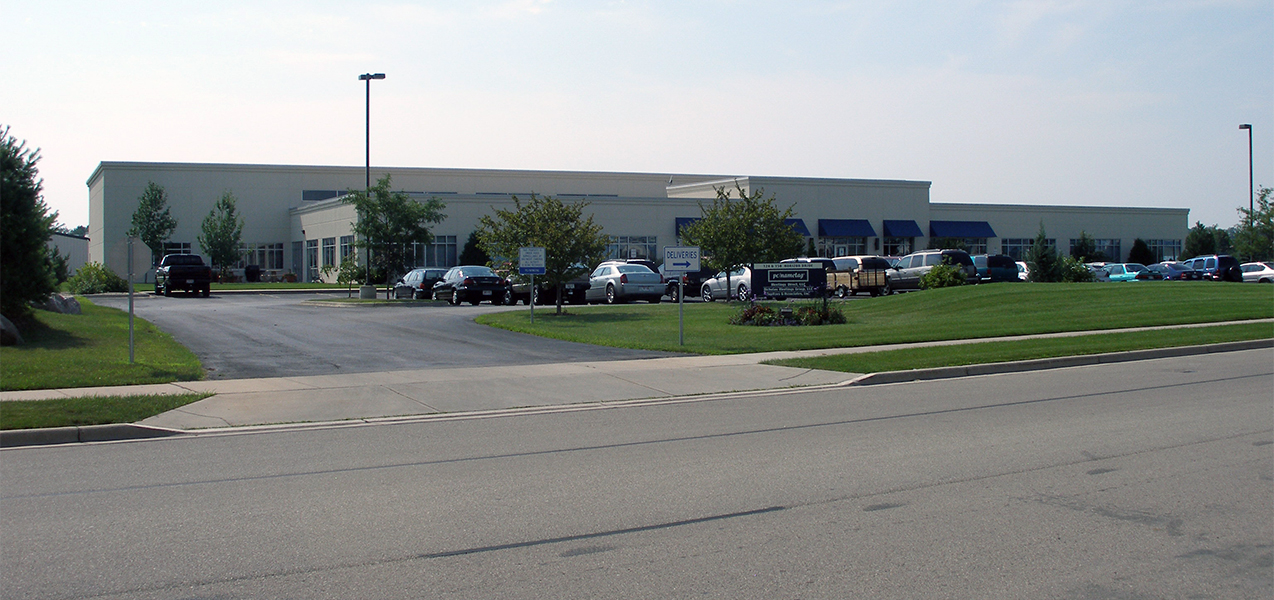 Entire front of the PC Nametag building in Wisconsin as seen from the highway.