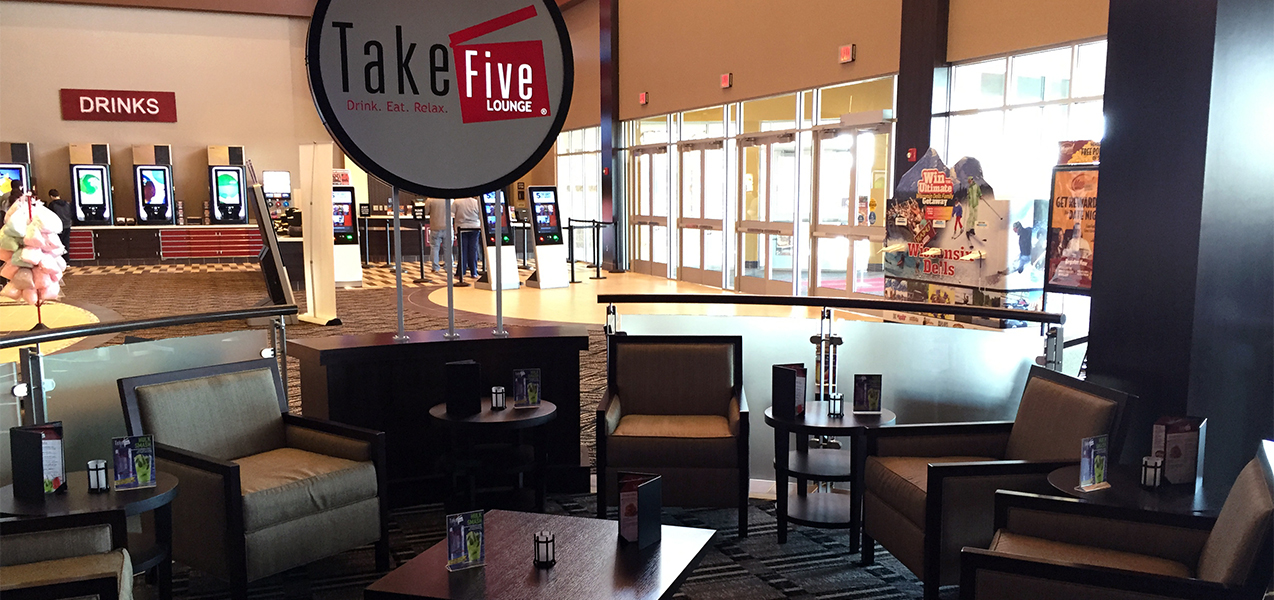 Take Five Lounge sign, seating area, facing front door of the Palace Cinema movie theater.