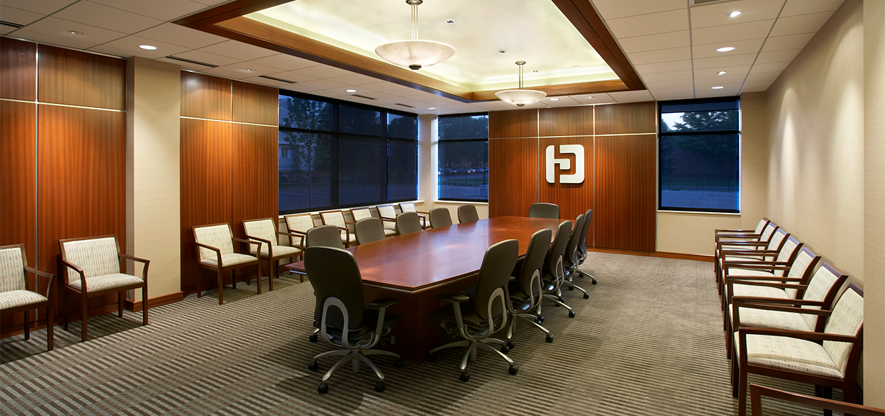 Large conference room with table and chairs in the Tri-North Builders remodel project for Park Bank Corporate Headquarters.