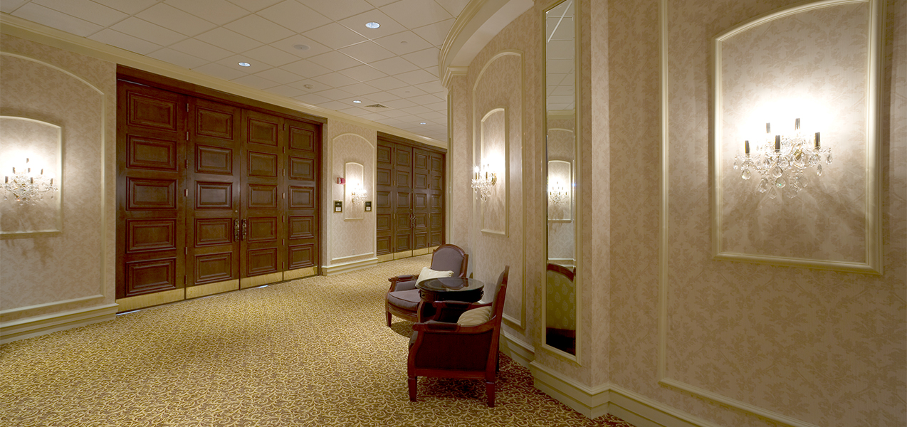 Hallway with chairs and door remodel project by Tri-North Builders at the Pfister luxury hotel in downtown Milwaukee, WI.